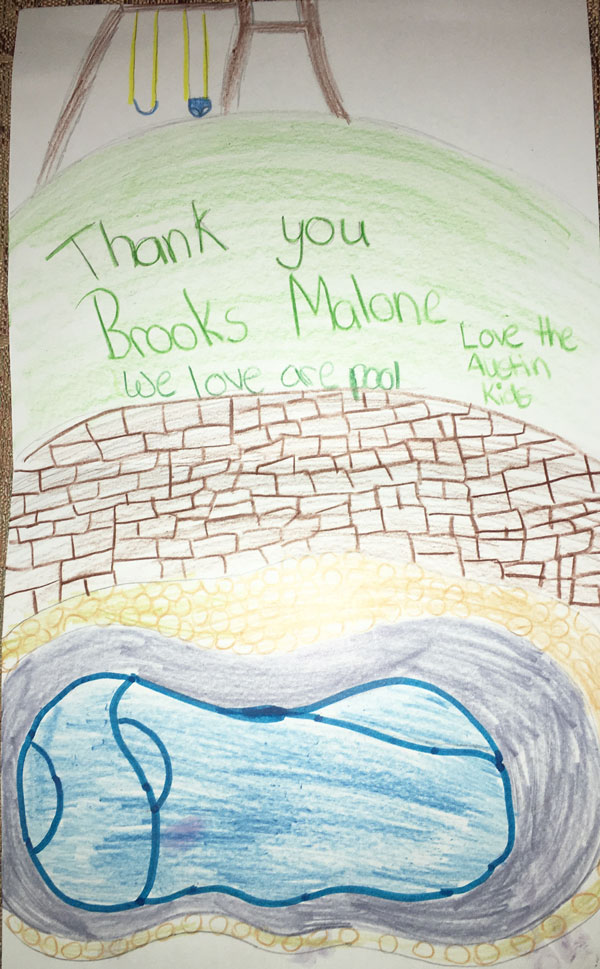 Children react in a written note with drawing to a new pool by Brooks Malone