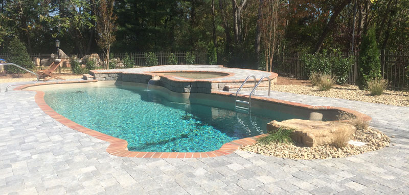 Fiberglass Pool With Waterfall and Tanning Ledge