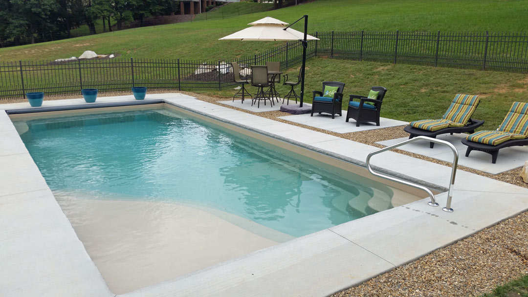 Fiberglass Pool With a Variety of Options for Lounging Poolside