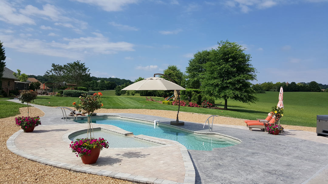 Swimming Pool In Huge Yard With Stunning Plantings Surrounding