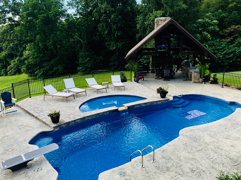 Double level pool with pavilion for entertaining