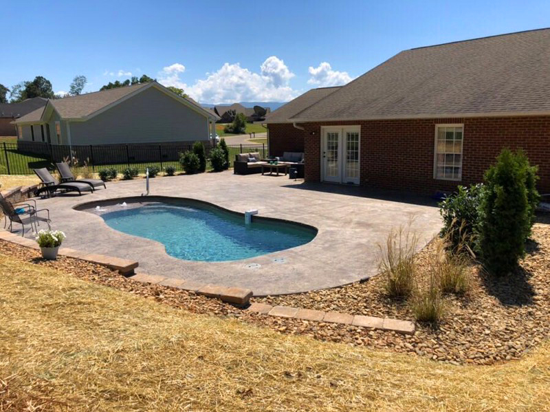Fiberglass pool on a small lot in a subdivision
