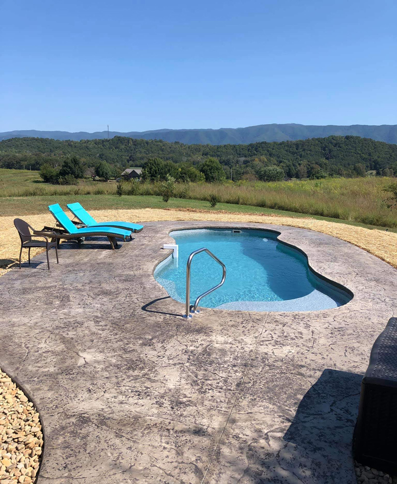 Fiberglass pool on a Tennessee hilltop overlooking the Blue Ridge Mountains in the distrance